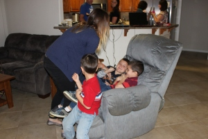 Sarah, tickling the boys.  Obviously, they were way too quiet and something needed to be done about that.